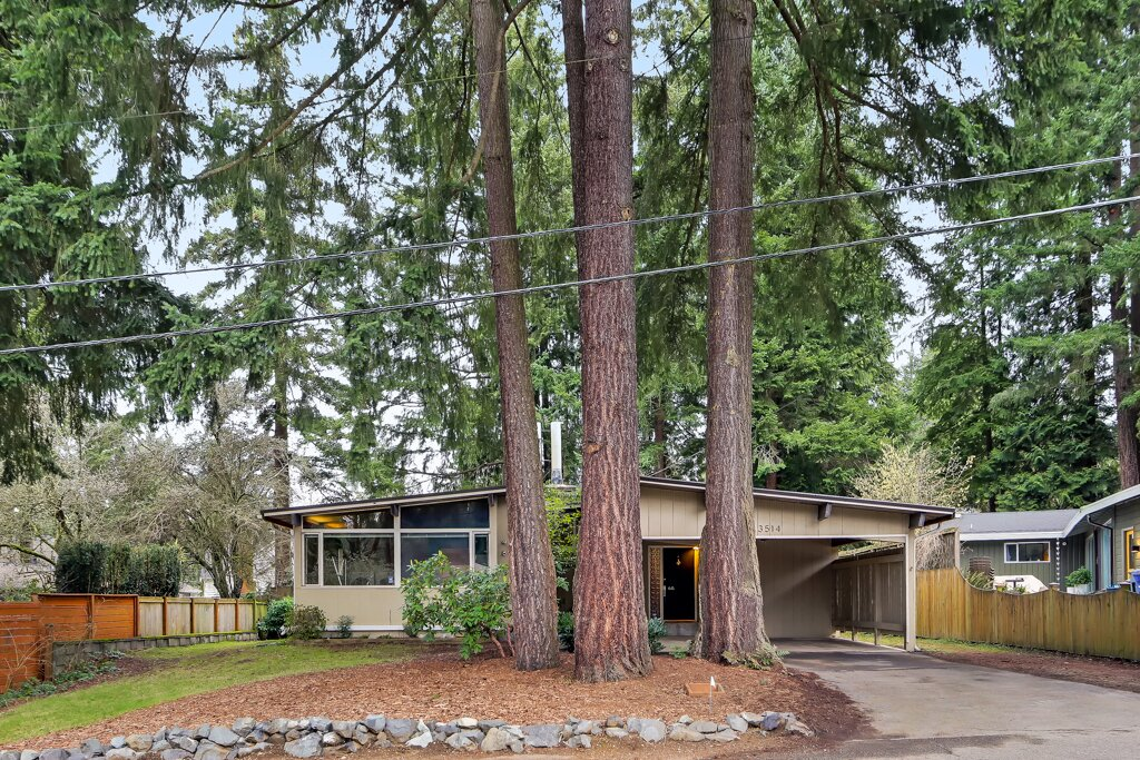 The 1953 home sits on a quiet lot in Lake Forest Park, a small suburb of Seattle originally developed in the 20th century as bedroom community for commuters to and from the city. Today, the area is home to around 13,400 people and is acclaimed for its convenient access to nature.  Photo 1 of 13 in A Sun-Drenched Midcentury Near Seattle Seeks $750K