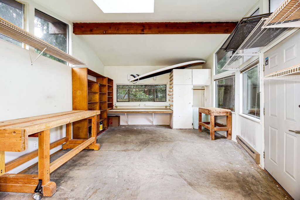 Additionally, the home includes a detached studio in the backyard—a bright and spacious area that can easily be converted into a home office, yoga space, or gym.  Photo 13 of 13 in A Sun-Drenched Midcentury Near Seattle Seeks $750K