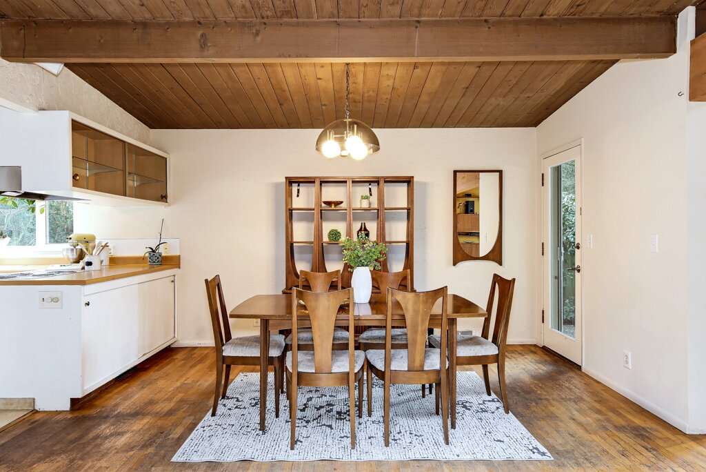 Original hardwood floors run throughout the dining area located steps away from the kitchen.  Photo 7 of 13 in A Sun-Drenched Midcentury Near Seattle Seeks $750K