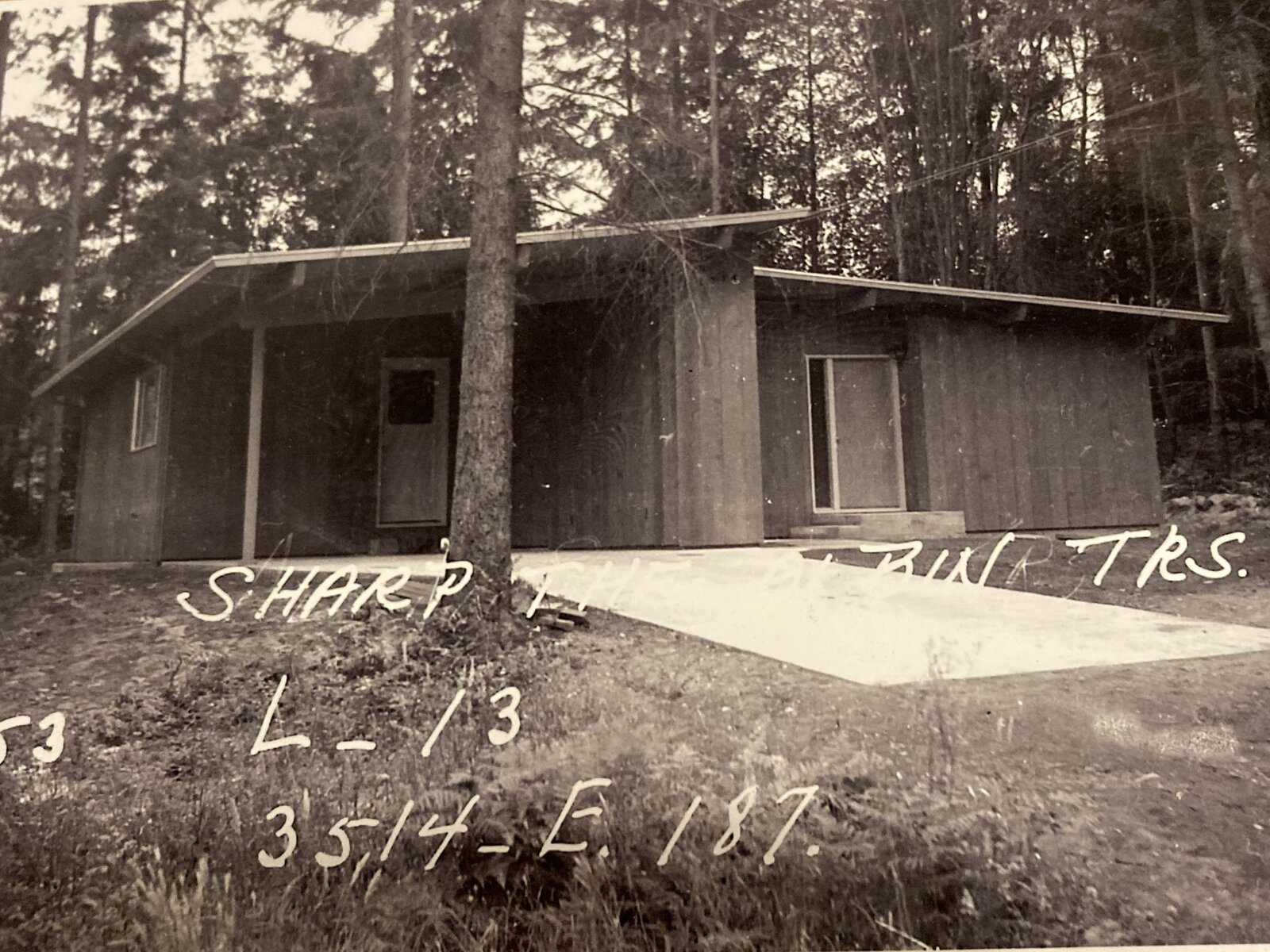 An archival photo of the 1950s home showcases its original footprint prior to renovations.  Photo 2 of 13 in A Sun-Drenched Midcentury Near Seattle Seeks $750K