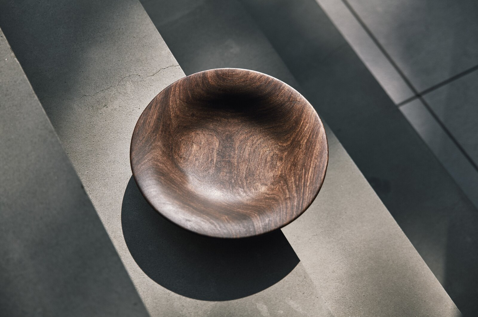 The epitome of slow design, each redwood serving bowl displays decades of natural growth rings in the woodgrain and takes Amadou many hours of hands-on work to complete.  Photo 6 of 11 in Obakki's New Collection of Handcrafted Bowls and Spoons Reveals the Beauty of Slow Design
