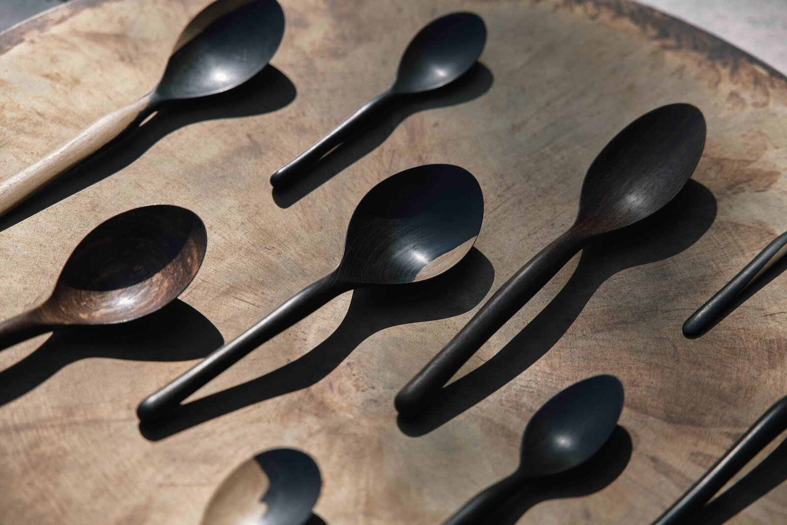 Pieces of discarded blackwood with white markings—supposedly undesirable features for mainstream wood products—lend a rough-hewn character to the handcrafted spoons.  Photo 9 of 11 in Obakki's New Collection of Handcrafted Bowls and Spoons Reveals the Beauty of Slow Design