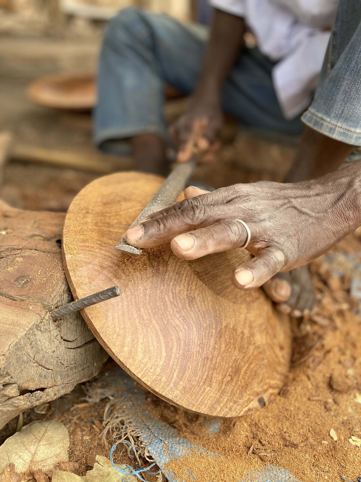 Using techniques passed down through generations, Amadou has mastered the art of hand-carving traditional wooden bowls without complex machines or fancy gadgets.  Photo 5 of 11 in Obakki's New Collection of Handcrafted Bowls and Spoons Reveals the Beauty of Slow Design