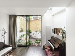 The basement family room opens to a below-grade walled garden.