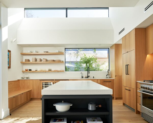 """""""Anthony and Sherry love to entertain, so they wanted something that felt a little more austere from the street and then became warm and cozy on the interio,"""" says architect Eric Hughes."""
