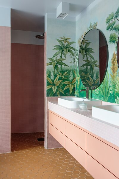 One of the home's bathrooms features wallpaper from Etsy retailer AwallonDesign.