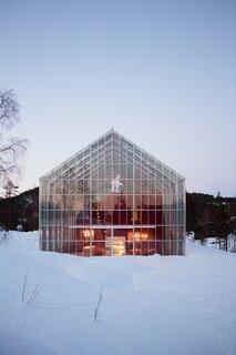 The home of architect Margit-Kristine Solibakke Klev and her husband, Arnstein Norheim, is built inside an enormous greenhouse.
