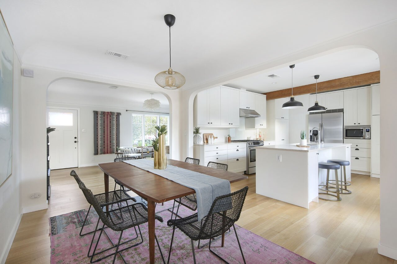 Broad archways connect the primary living spaces, catering to seamless entertaining.  Photo 5 of 15 in A Spanish-Style Charmer With a Backyard Studio Slides Onto the L.A. Market at $1.4M