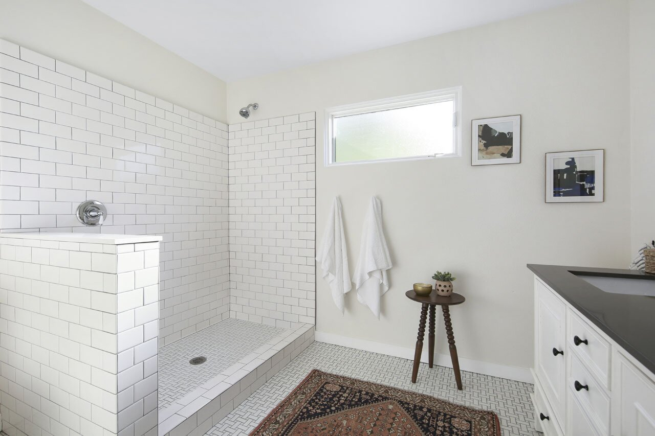 Another one of the bathrooms, which includes an oversized shower, lined with subway tiles.  Photo 10 of 15 in A Spanish-Style Charmer With a Backyard Studio Slides Onto the L.A. Market at $1.4M