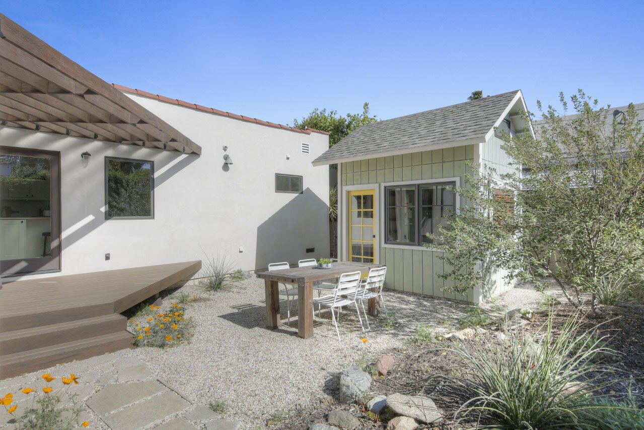 Native landscaping in the backyard sets the scene to enjoy al fresco dining.  Photo 11 of 15 in A Spanish-Style Charmer With a Backyard Studio Slides Onto the L.A. Market at $1.4M