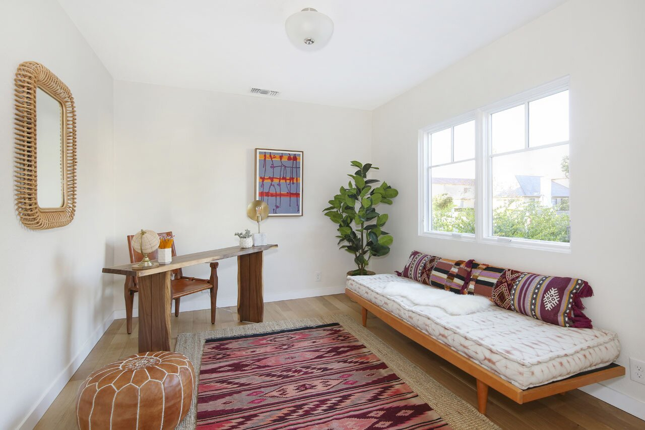 A smaller sitting area, which can also serve as a home office, sits across the main living room.  Photo 4 of 15 in A Spanish-Style Charmer With a Backyard Studio Slides Onto the L.A. Market at $1.4M