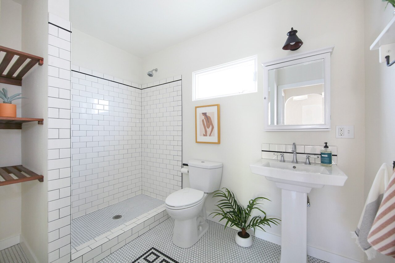 Each of the three bathrooms also received full makeovers, including unique tilework.  Photo 8 of 15 in A Spanish-Style Charmer With a Backyard Studio Slides Onto the L.A. Market at $1.4M