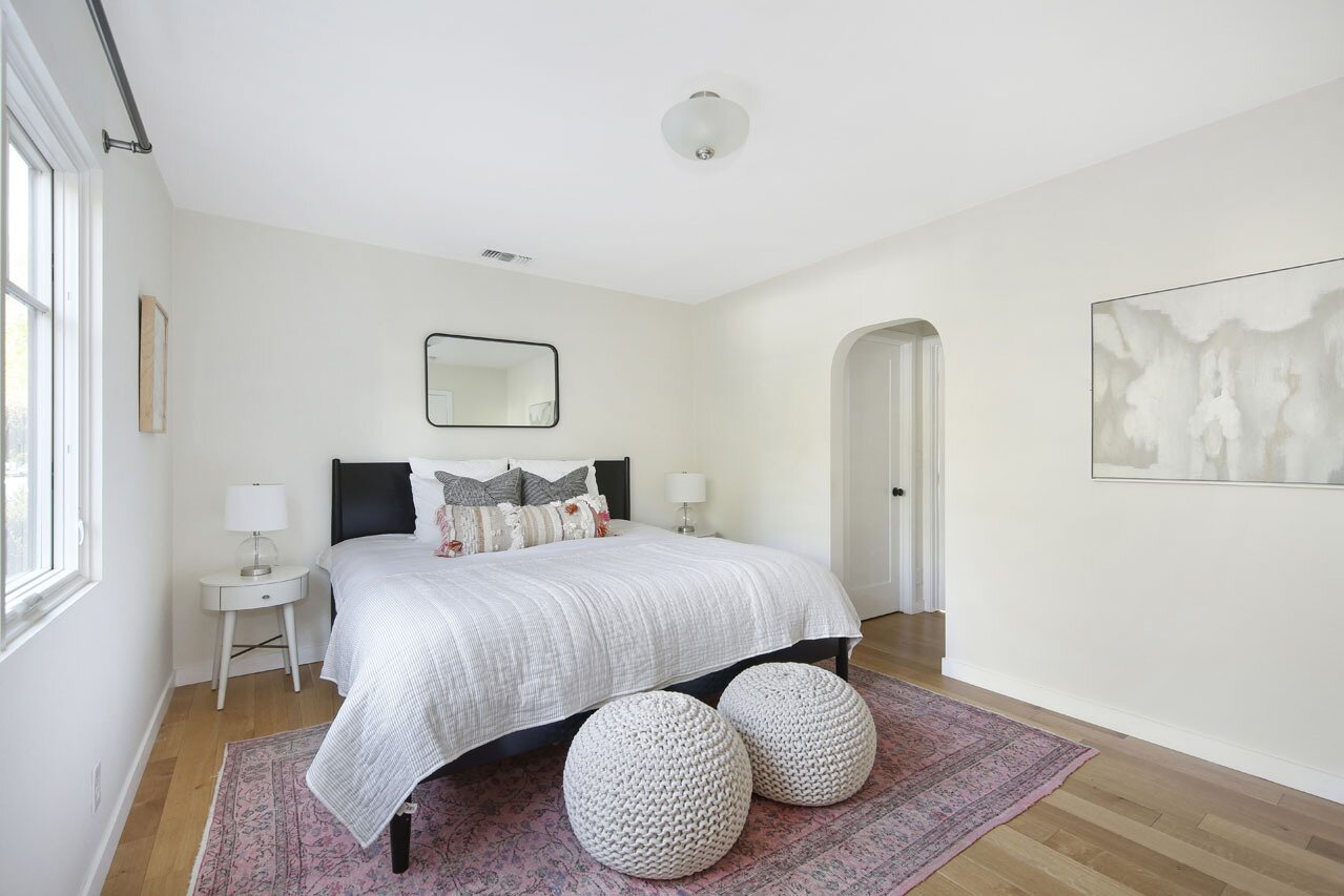 Arched openings and hardwood floors continue into all of the four bedrooms.  Photo 9 of 15 in A Spanish-Style Charmer With a Backyard Studio Slides Onto the L.A. Market at $1.4M