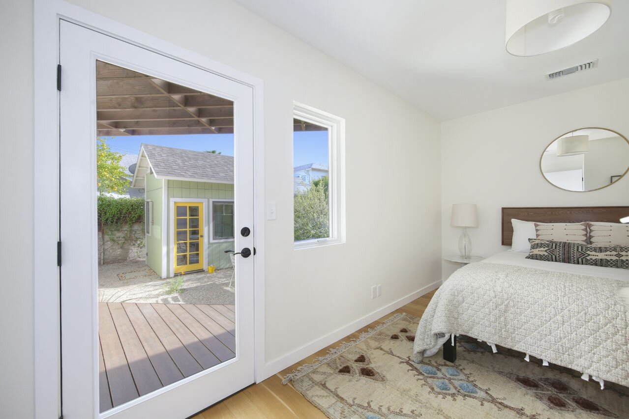 A wide, glass door in the principal suite offers direct access to the backyard.   Photo 7 of 15 in A Spanish-Style Charmer With a Backyard Studio Slides Onto the L.A. Market at $1.4M