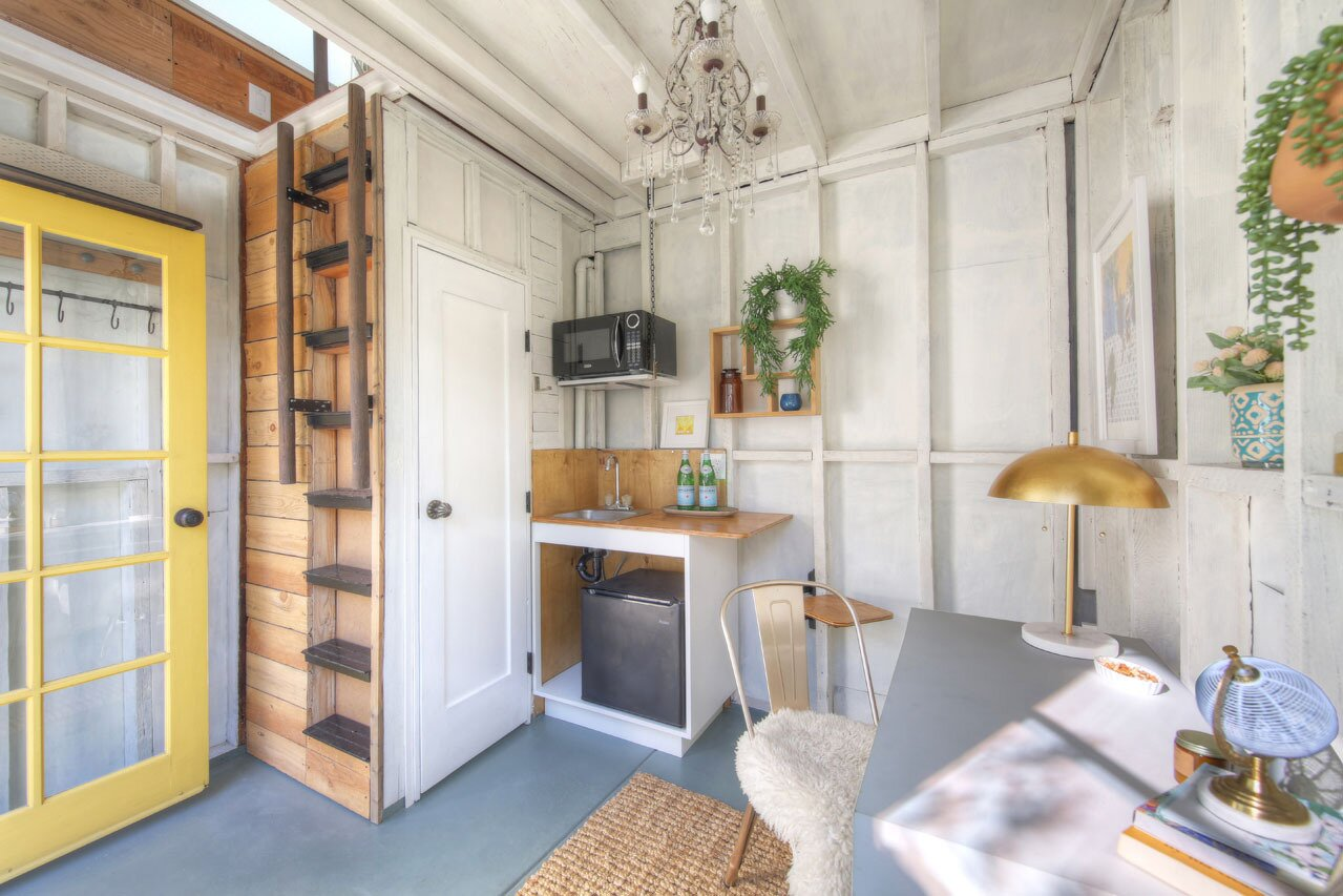 The turn-key studio offers an idyllic corner for overnight guests, as well as various creative pursuits. A half-bath sits on the other side of the door, next to the small kitchenette.  Photo 12 of 15 in A Spanish-Style Charmer With a Backyard Studio Slides Onto the L.A. Market at $1.4M