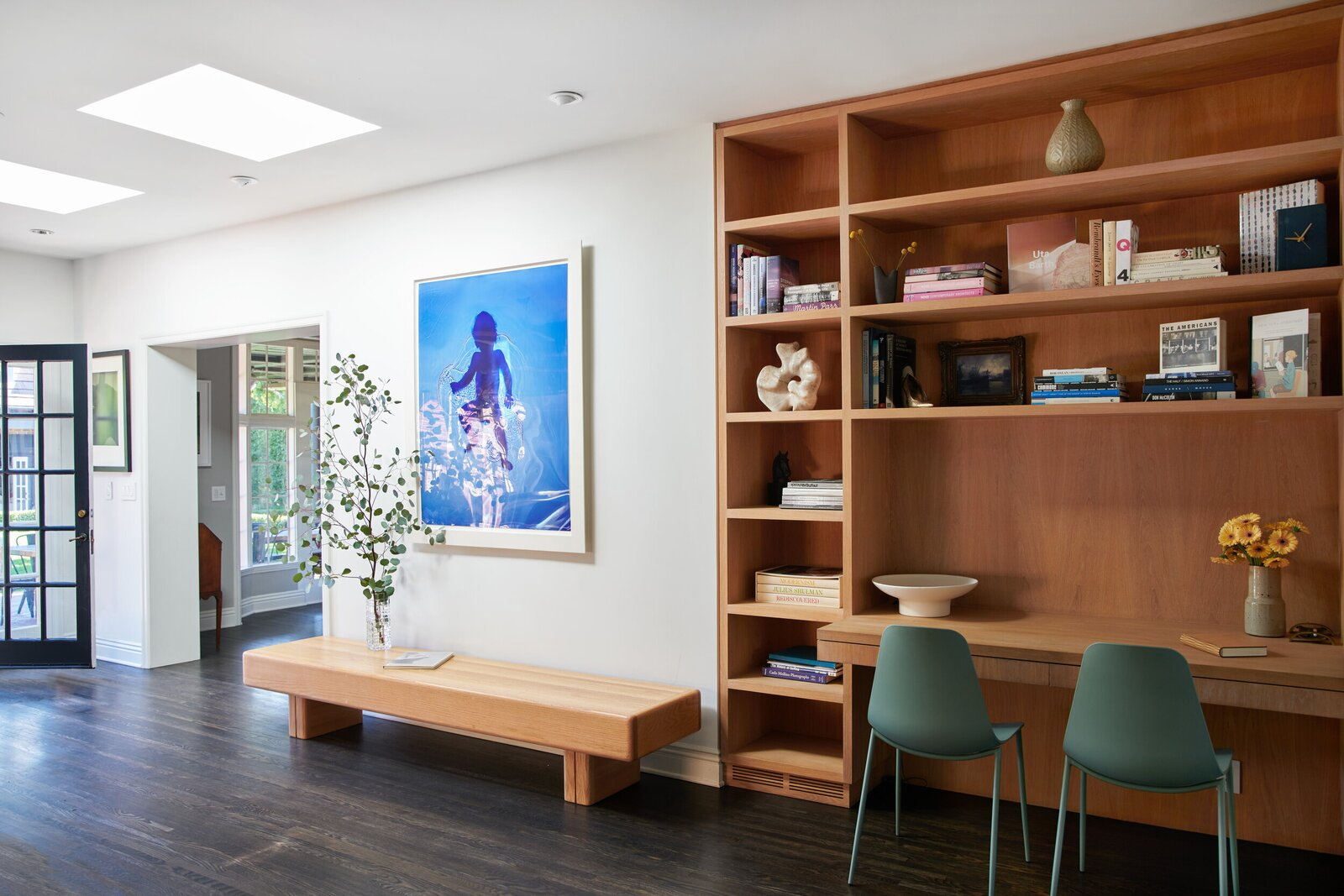 In the hallway on the main level, a handcrafted, built-in shelving unit offers a small desk area.  Photo 6 of 15 in A Posh Tudor-Style Home in L.A. Seeks $7M