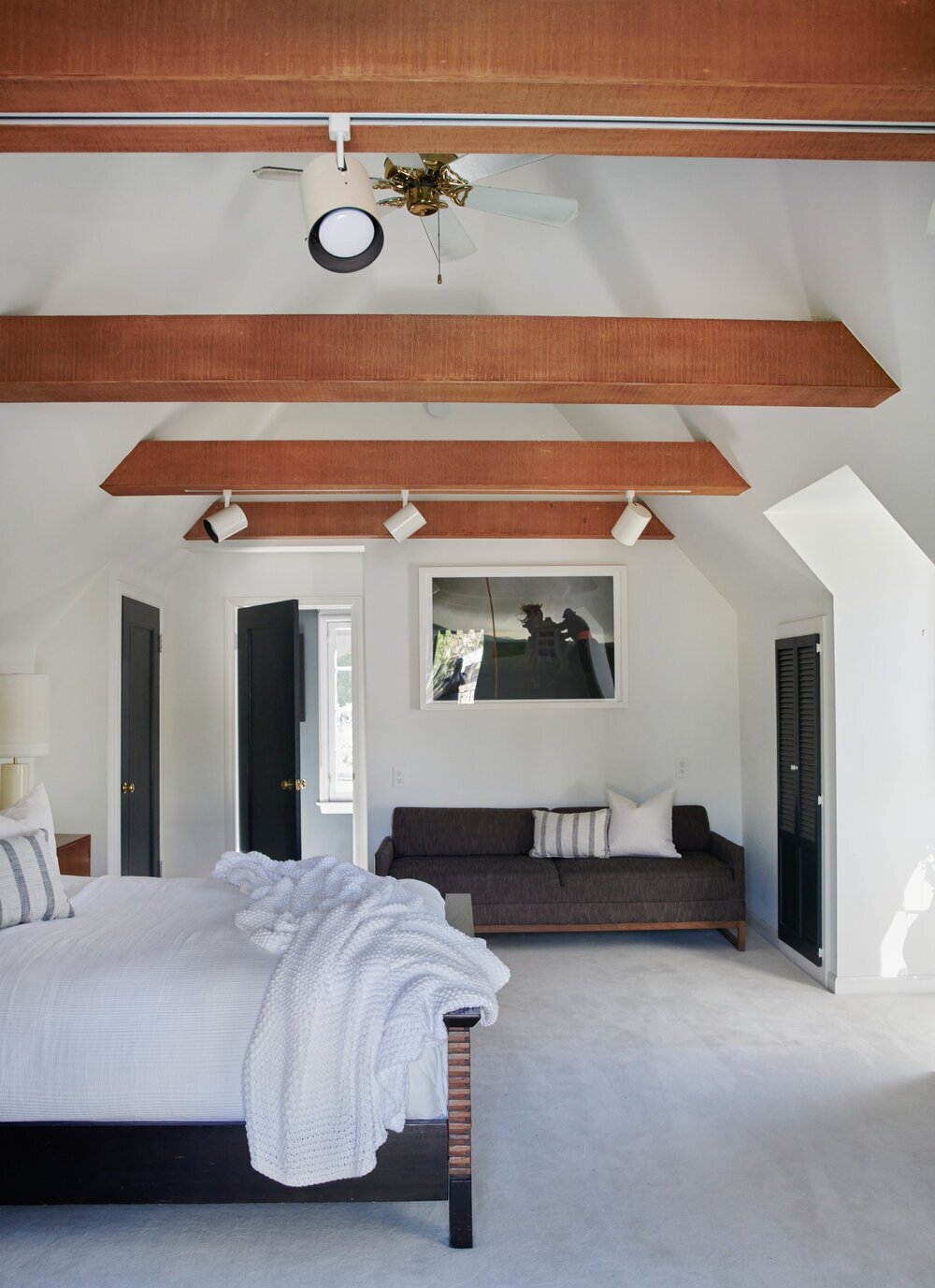 Wooden beams span the ceiling in the upper-level bedroom of the guesthouse, which comes with a remodeled bath.  Photo 15 of 15 in A Posh Tudor-Style Home in L.A. Seeks $7M