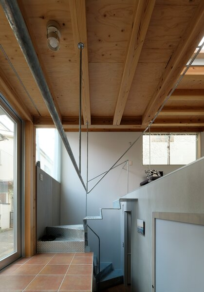 """""""While each floor is assigned a function, the spaces are connected through open floor plans and offset levels, which enlarge the space and counter the smallness of the house,"""" says Unemori."""