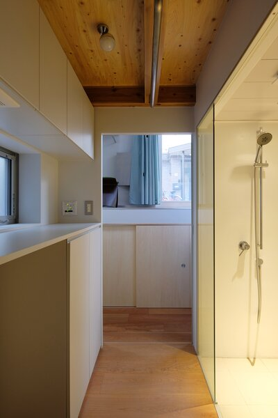 Pocket doors separate the bedroom from the bath, which includes a large glass shower.