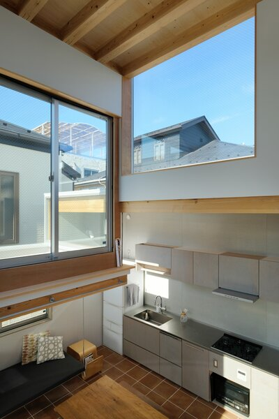 """""""The structure of House Tokyo was built with wood, which can still be seen in the interior design of the residence,"""" notes Unemori. """"The open-plan kitchen and dining area were placed on the first floor where the spacious overhead area is dominated by the framework's wooden beams."""""""