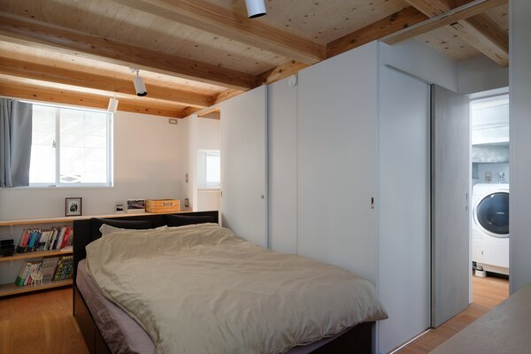 While housed in the semi-basement level, the bedroom is illuminated with ample natural light.