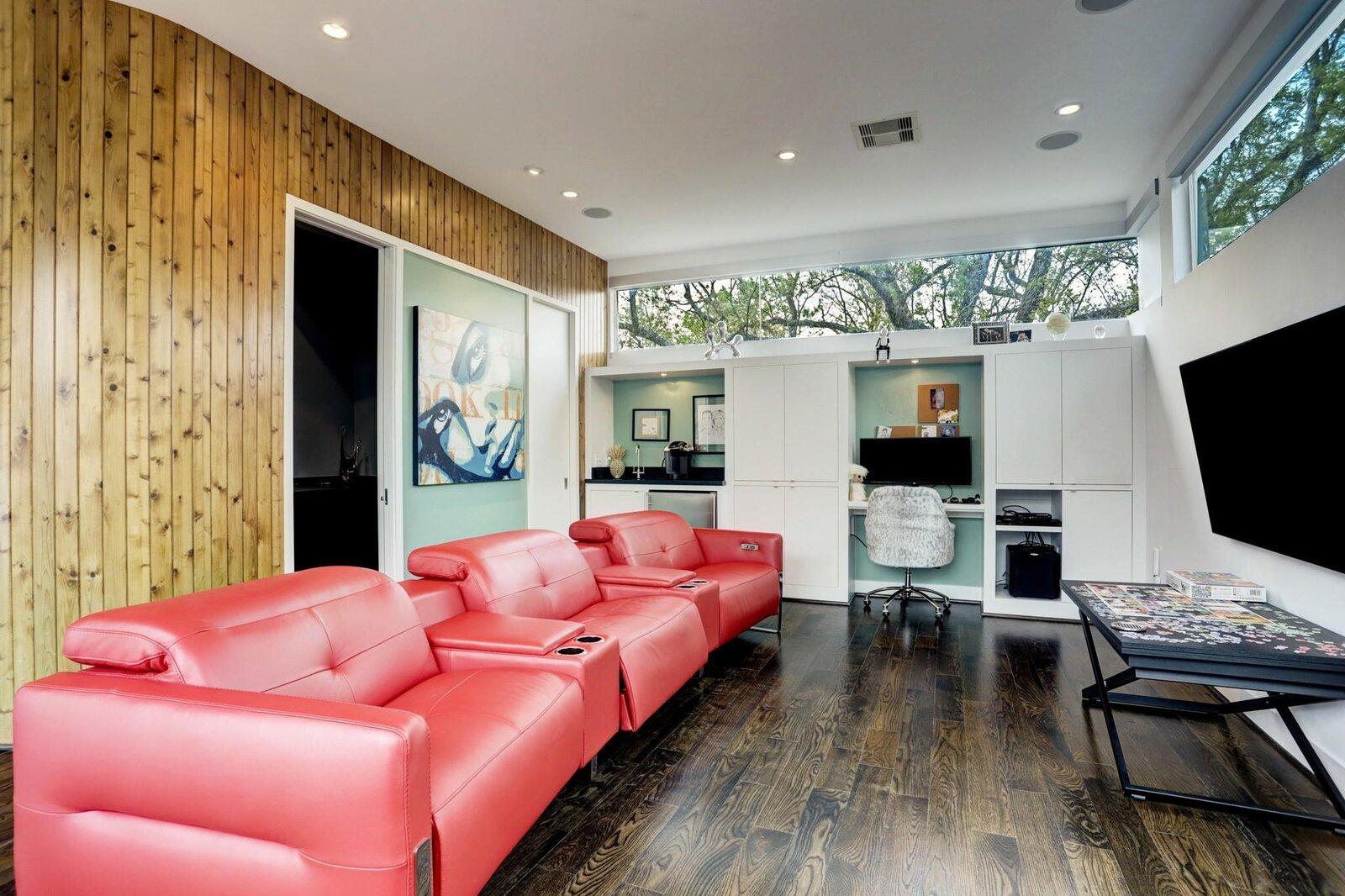 Allen Bianchi Houston home media room with desk and wet bar