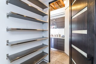 A spacious, walk-in pantry is located off the kitchen.