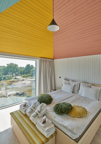 A large picture window near the bed captures mesmerizing views of the surrounding reserve.