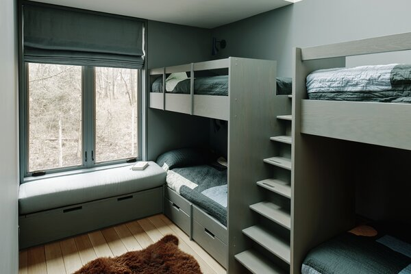 Custom bunk beds in the kids' room were designed by ALAO and fabricated by Amber Construction & Design. The quilts are from Cold Picnic and the stool is by Alvar Aalto for Artek.