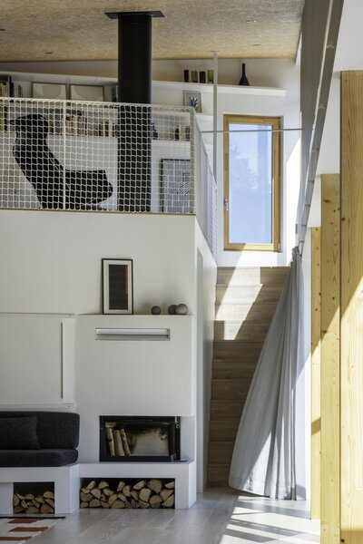 At the end of the interior is a small loft; the flue from the downstairs fireplace rises through it.