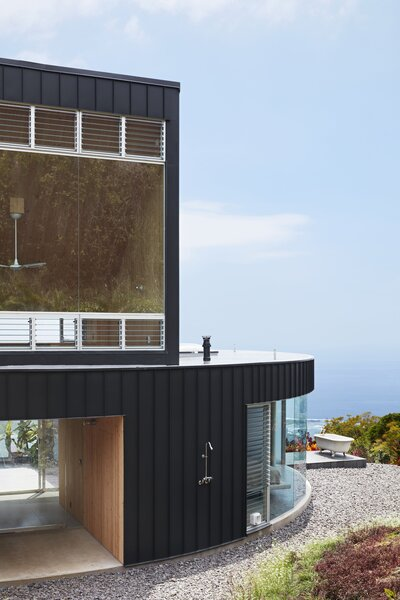 """Outdoor bathing options include a shower and a clawfoot tub. The fixtures are from Chicago Faucets. The loft orients the house toward a point at the edge of the bay. """"The building itself is like a navigation device,"""" says Steely. """"It's like a compass."""""""