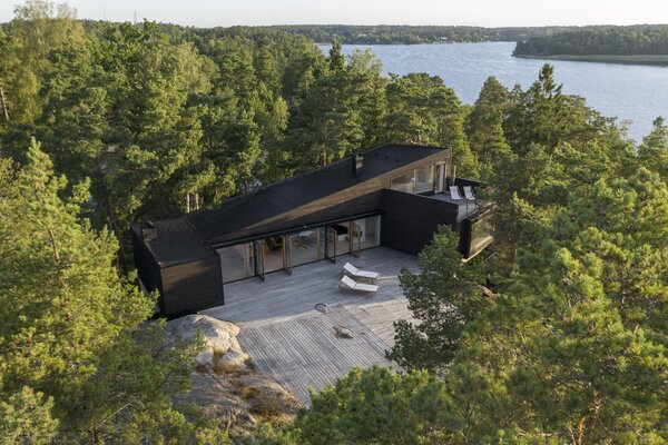 """The house is balanced atop a rocky slope. """"Not one millimeter of rock was blasted away,"""" says Rickard, who deferred to the topography in his design."""