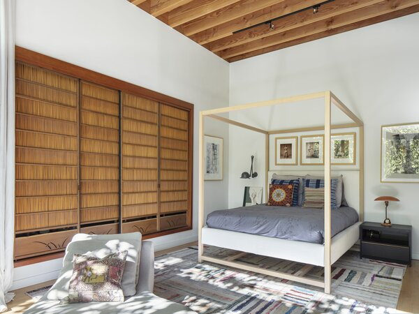 """In the couple's guest room, authentic shoji screens have been converted into sliding closet doors. """"I have a slight obsession with Japanese precision and culture,"""" Mel says."""