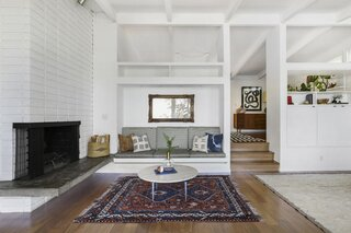 Overlooking the Silver Lake Reservoir, the 1961 home boasts a trove of vintage flair, including custom built-ins, ceilings with exposed beams, and a central fireplace.