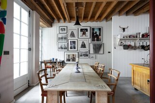 Set near the kitchen, the sun-kissed dining area caters to seamless entertaining and features an expansive wooden table that can easily accommodate eight guests.