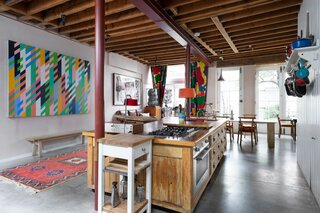 Another view of the kitchen showcasing the ensemble of natural light and a bright, bold patterns.