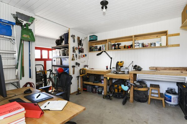 While the detached studio is currently set up as a workshop, it can easily be converted into a home office, gym, or tiny guest suite.