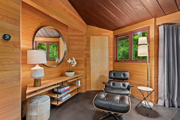 The walls and ceilings, dressed in different forms of wood, present a bold yet cozy aesthetic.