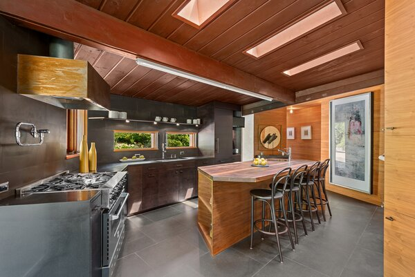 The kitchen comes with walnut cabinets, top-of-the-line appliances, and heated floors.