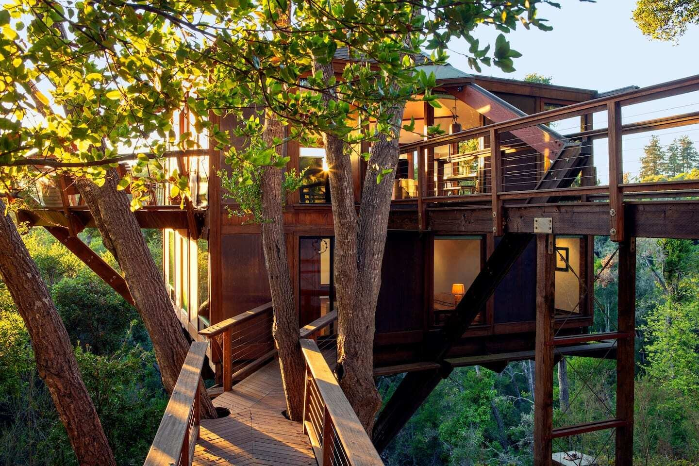 Located just south of San Francisco in Santa Cruz, California, this heavenly home is perfect for a weekend getaway if you're in the Bay Area. Complete with ocean views and large glass windows that surround the entire structure, it can sleep up to six guests.  Photo 2 of 9 in 9 Breathtaking Tree Houses You Can Rent on Airbnb This Summer