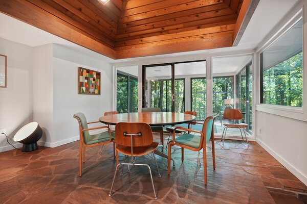Stone floors line the dining area, complementing the fireplace steps away.