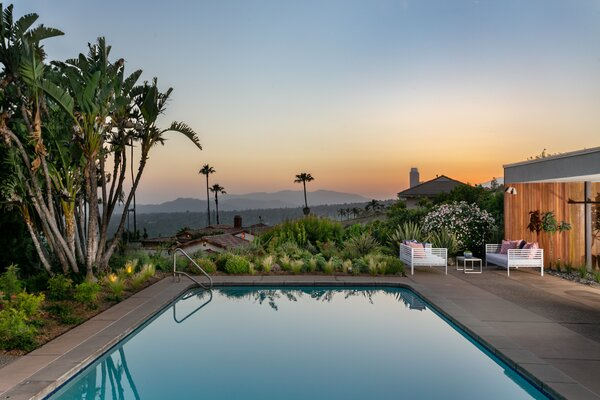 With the city below and the mountains beyond, the backyard presents an idyllic setting for memorable entertaining.