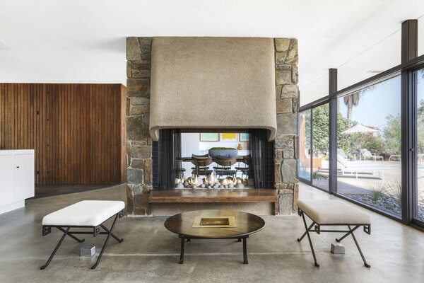 A double-sided, Bouquet Canyon stone-clad fireplace links the living and dining spaces.