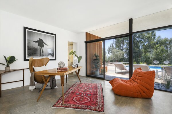 The home also features a bonus room which is currently set up as an office. Sliding glass doors connect the space to the backyard.