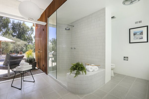 Connected to the bedroom is a spa-like bath, complete with an oversized glass shower.