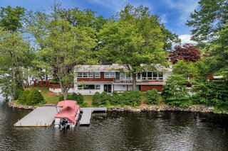 Beastie Boys' Ad-Rock Lists His Lakefront Midcentury for $975K