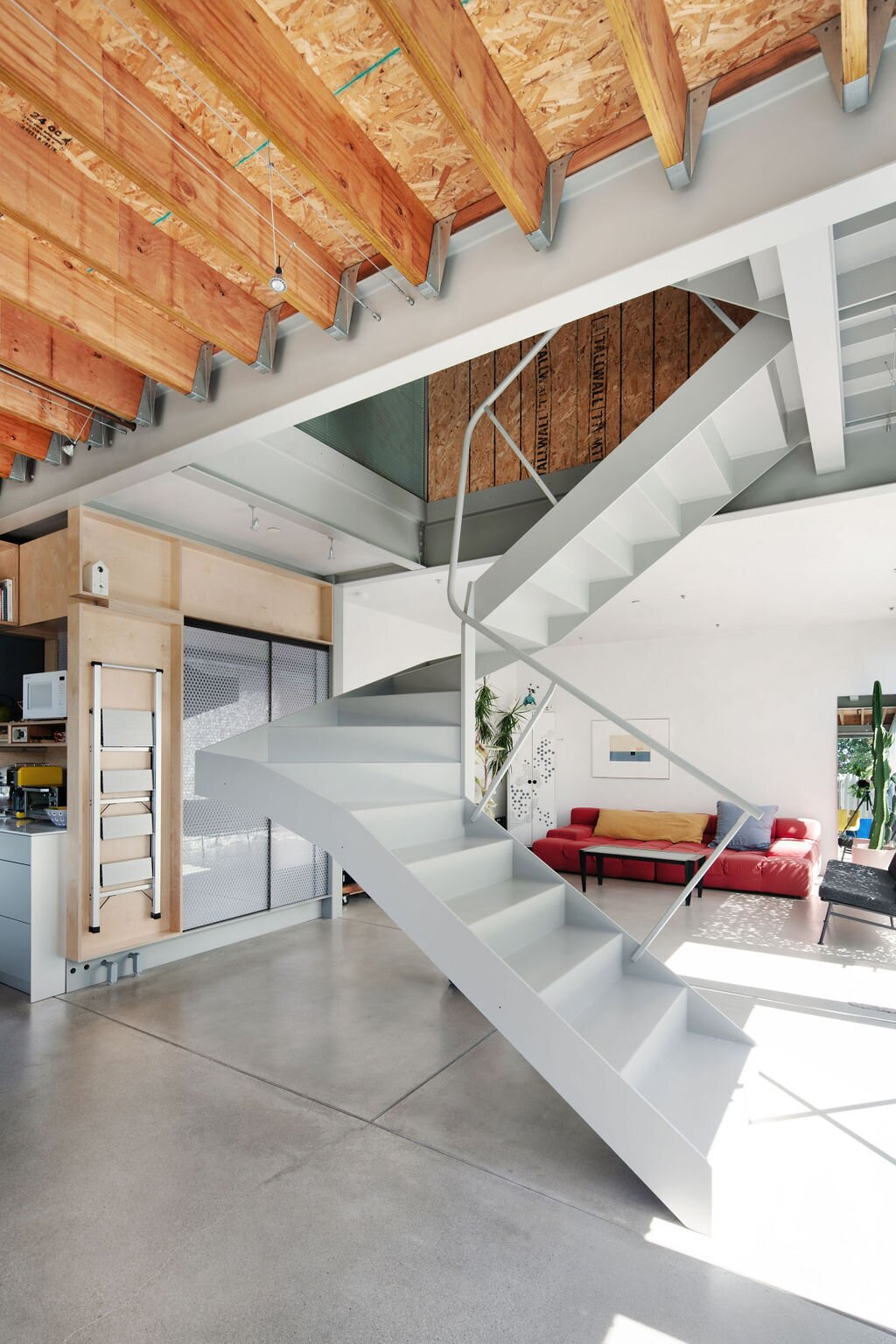 """""""The ground floor is great for hosting; the concrete floors, glass walls, and front yard make these main living spaces feel inviting and casual,  Photo 6 of 14 in Listed for $2.7M, This Architect's Award-Winning Home in Southern California Is a Must-See"""