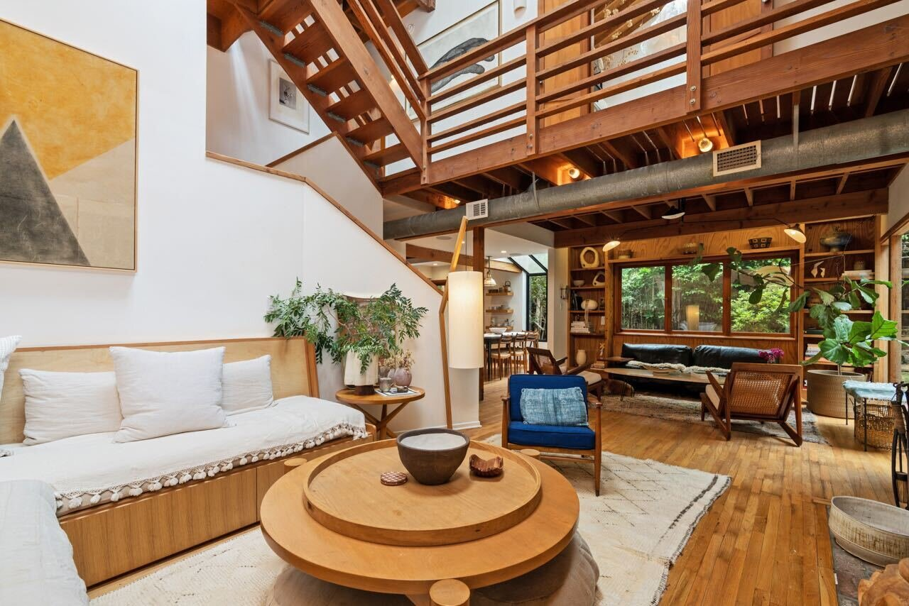 The view from the back of the living room showcasing one of the upper mezzanine levels.  Photo 4 of 14 in A Tree House–Like Dwelling Near the Coastline Seeks $3.89M in Santa Monica, CA