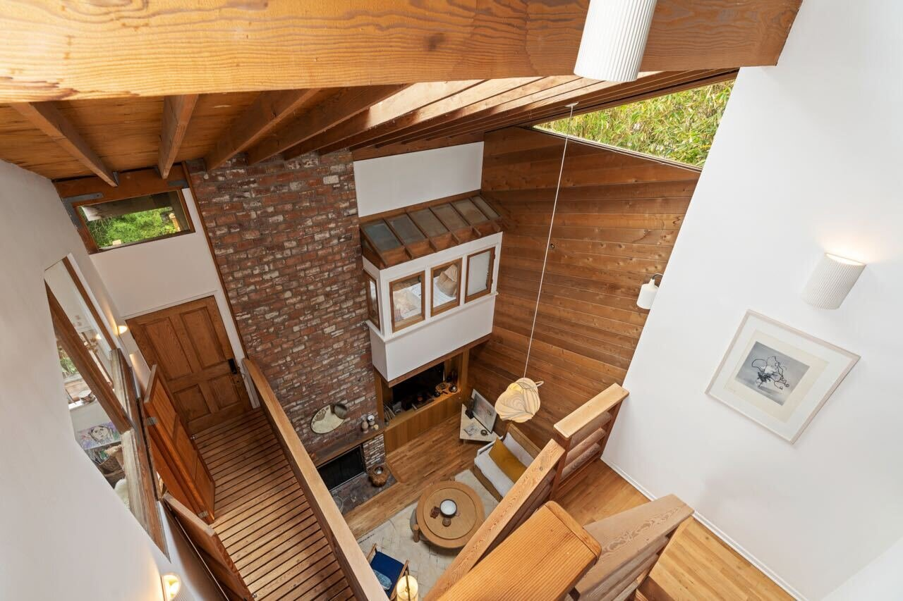 The view from one of the upper levels overlooking the ground-floor living areas.  Photo 7 of 14 in A Tree House–Like Dwelling Near the Coastline Seeks $3.89M in Santa Monica, CA