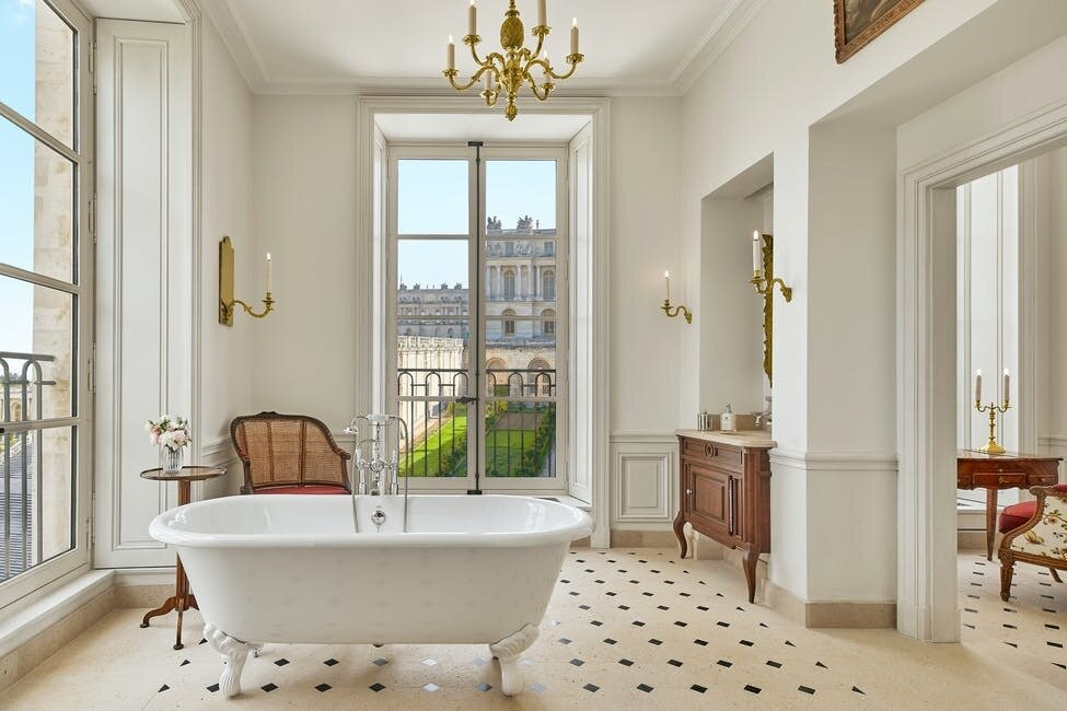 Each room of the hotel presents unparalleled views of the Palace grounds.  Photo 7 of 11 in The Palace of Versailles Opens a New Hotel Where Guests Can Live Like Royalty